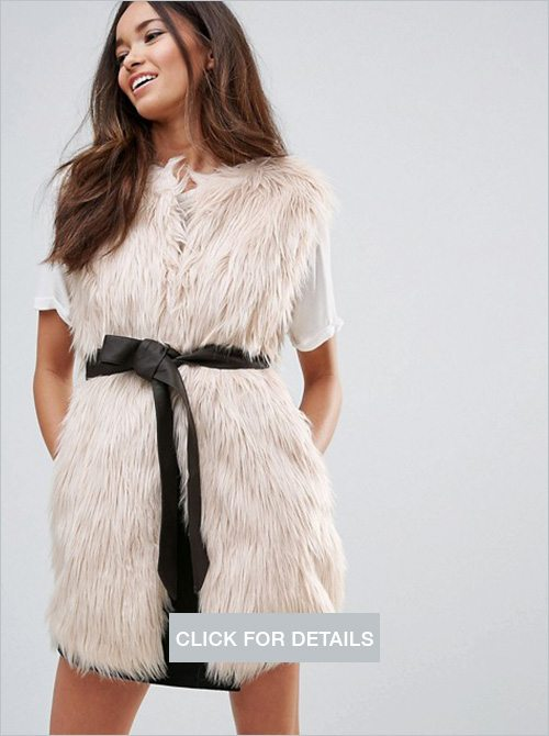 Urban Bliss faux fur vest with PU belt